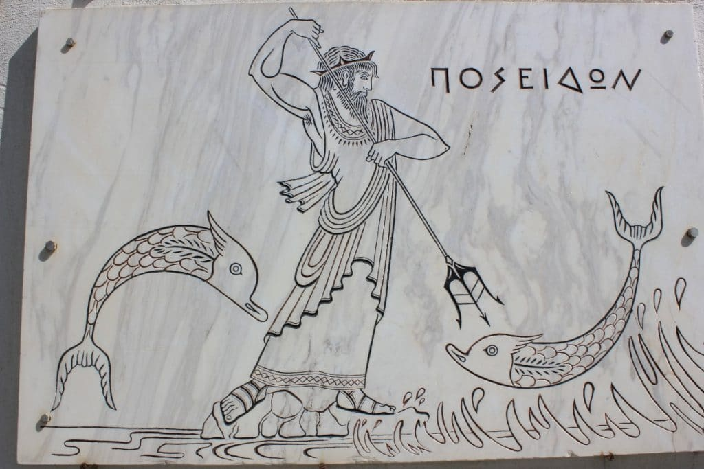 Dibujo de Poseidón y dos peces.