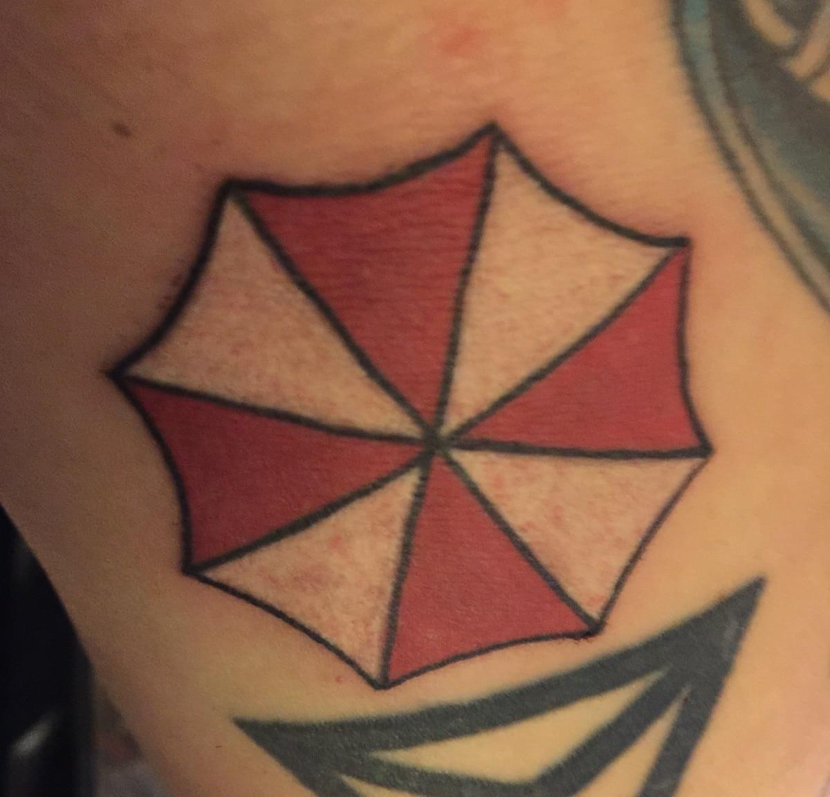 Tatuaje del logo de Umbrella