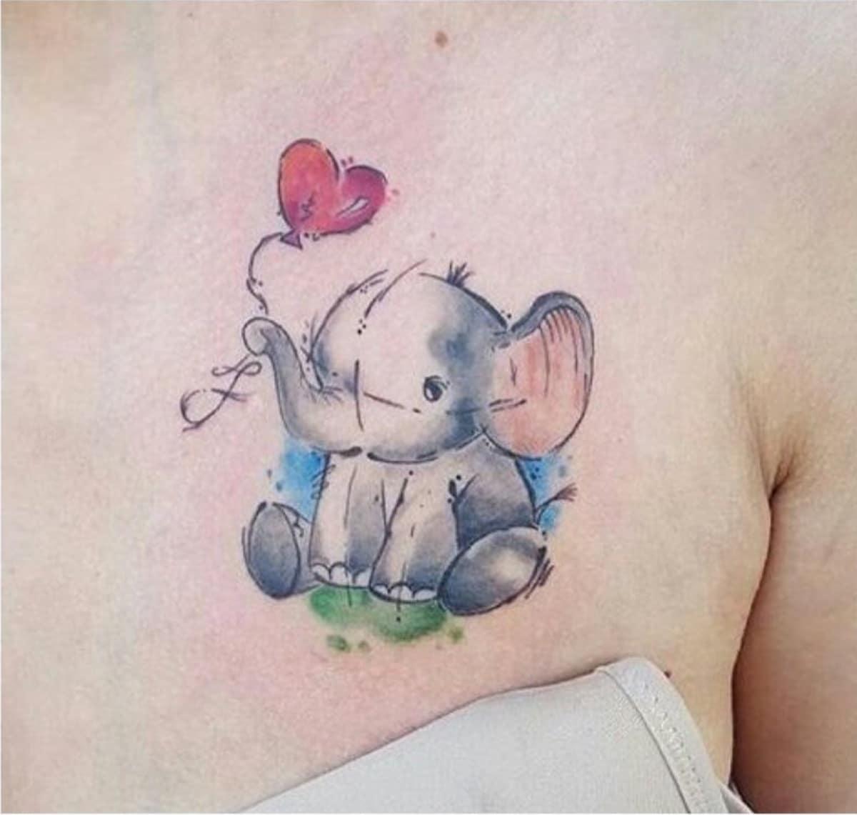 Tatuaje de estilo infantil con elefante y globo