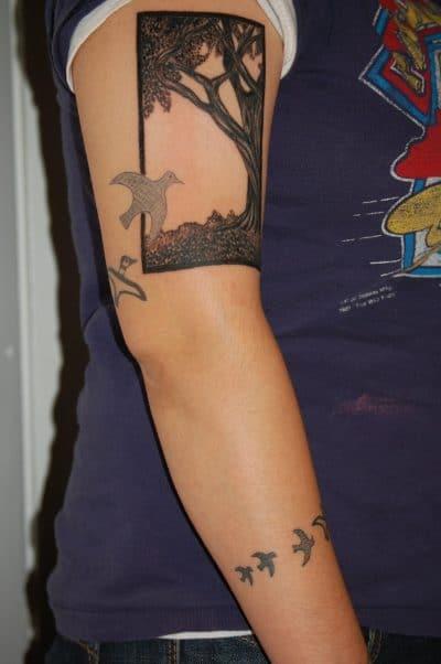 Tatuaje de olivo y paloma