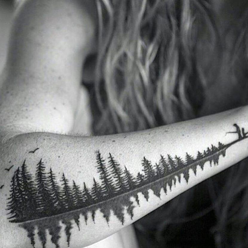 Tatuaje silueta de bosque