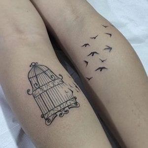 Tatuaje de jaula y pájaros