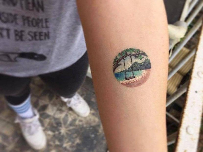 tatuaje playa columpio