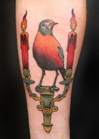 Tatuaje petirrojo velas