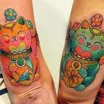 Tatuajes de gatos de la suerte