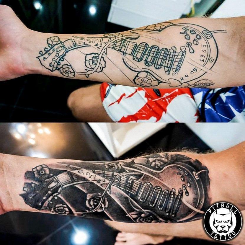 Tatuaje guitarra brazo