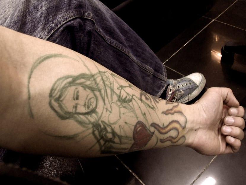 Tatuaje Jesús brazo