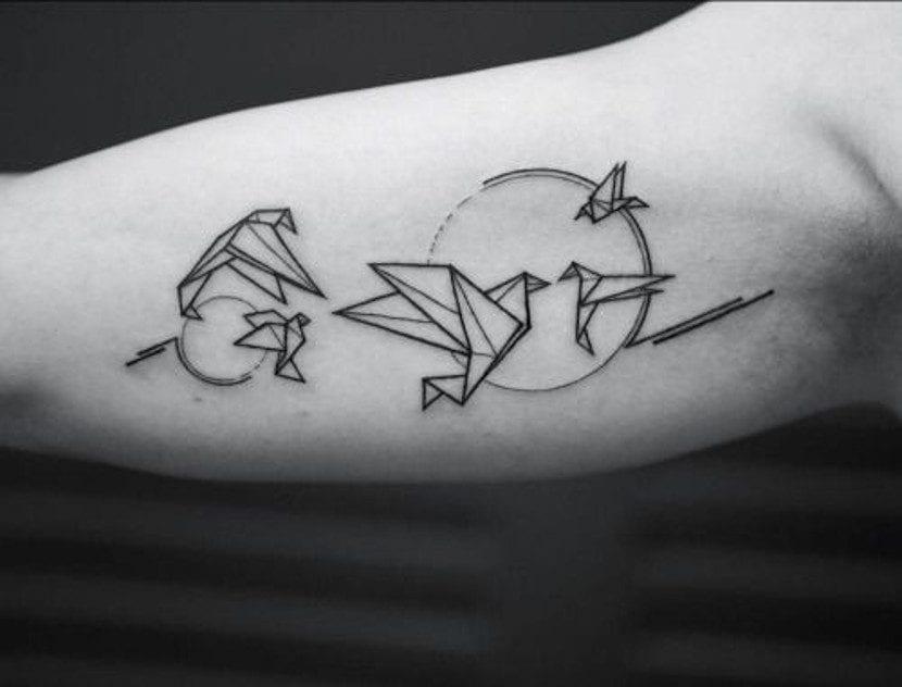 TAtuajes de origami en el brazo