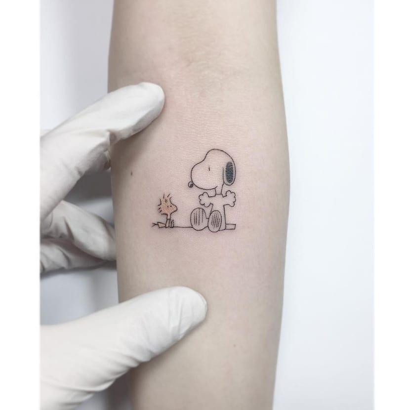 Tatuajes de Snoopy brazo