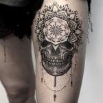 Tatuajes de calaveras en el muslo