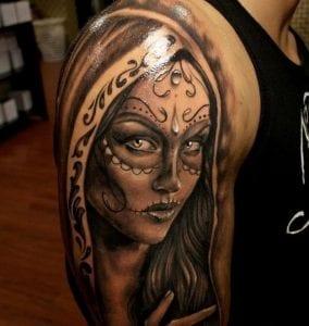 Tatuajes de Catrinas en el brazo